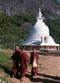 "Buddhist monks in front of a ""dagoba"" on the foot of ""Adam's Peak"""